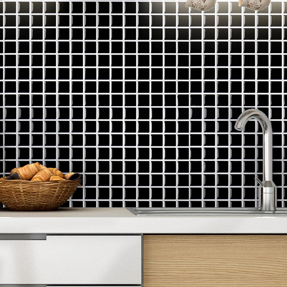 black mosaic tiles behind sink
