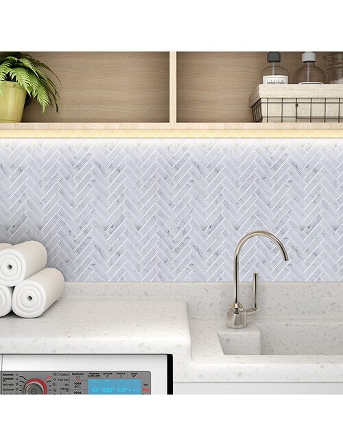 laundry room herringbone tile