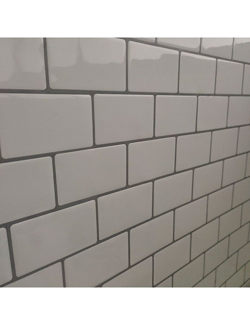 white subway tile with grey grout