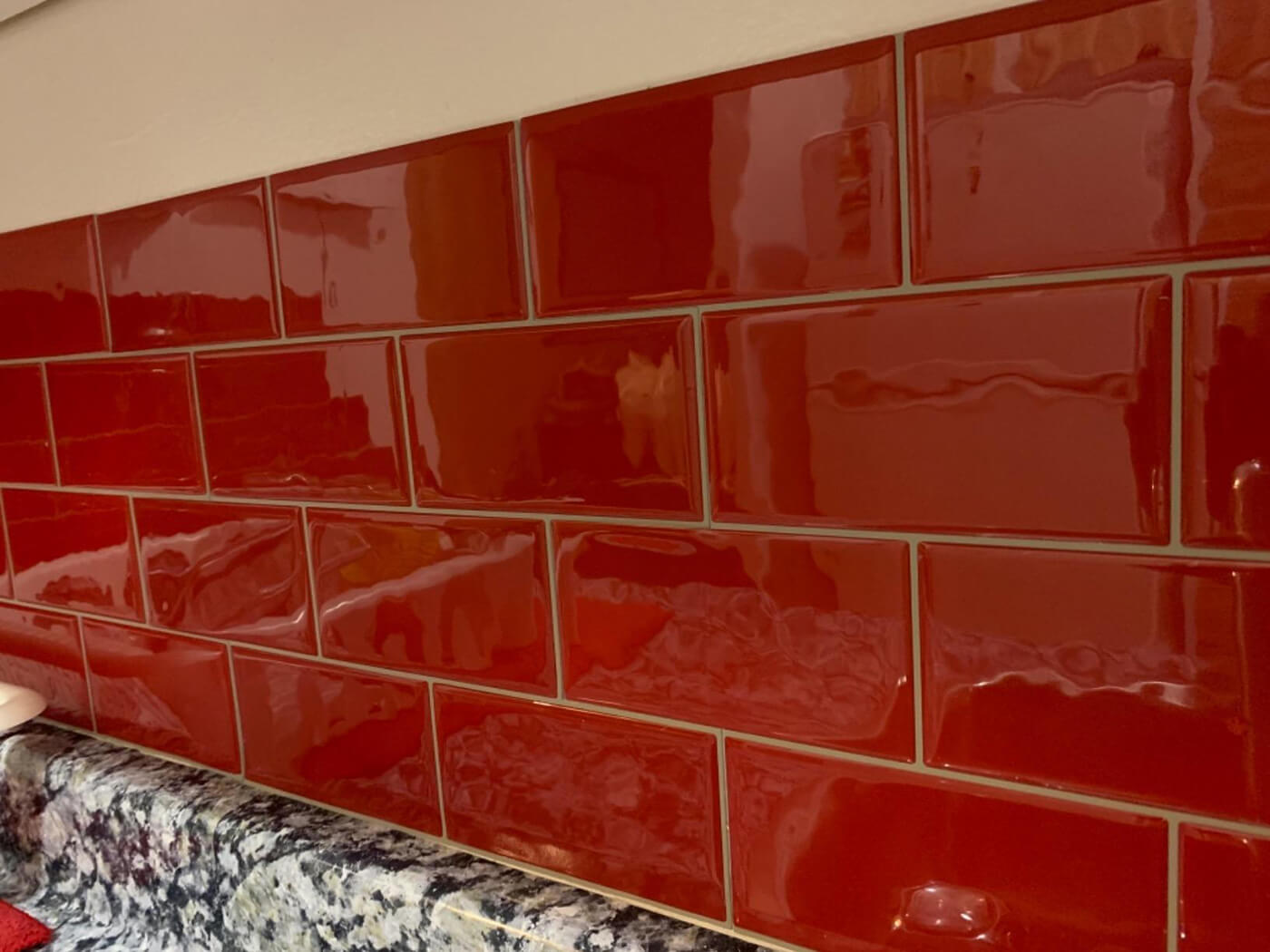 red subway tile kitchen