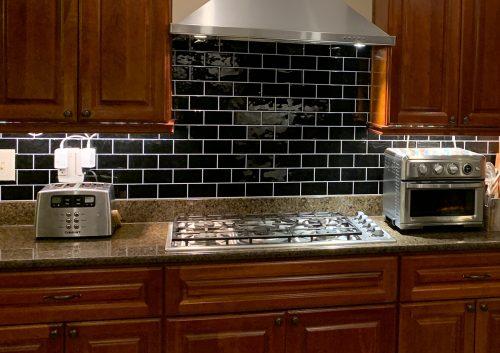 black subway tile for kitchen