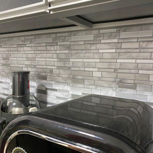 kitchen backsplash with Carrara marble tile