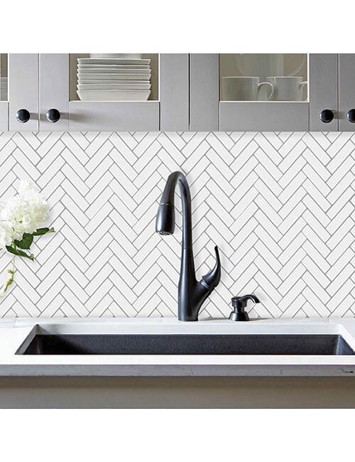 white herringbone wall tile backsplash