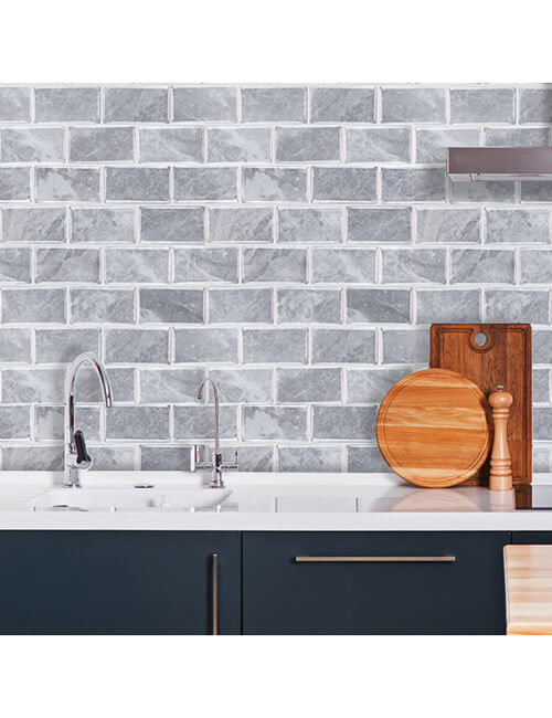 gray stone brick tiles for walls behind the sink
